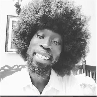 South Sudan's current Minister for Water Resources and Irrigation steps out in Afro wig