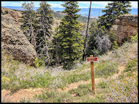 Sign by the View area to direct you to trail to right fork, otherwise you might end up of a ATV road that heads out a ways.