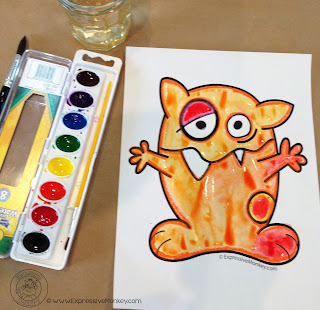 Warm Colored Monster - Use monsters and this watercolor technique that uses plastic wrap to teach about warm and cool colors. - Warm Colors - Color Art Lesson Idea - Painted Monster Lesson