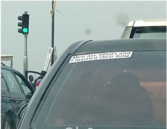 """Men Are Idiots And I Married Their King,"" Car Sticker Reads"