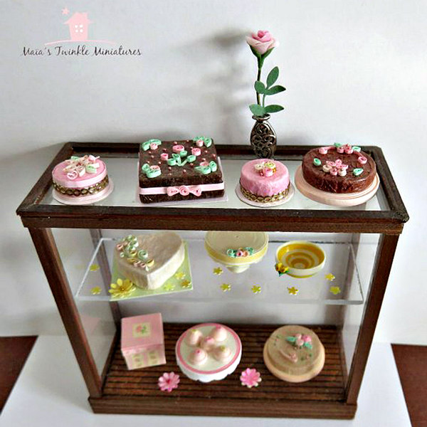 quilled miniature baked goods and flowers