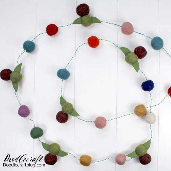 Make the cutest pom pom garland with Baby Yoda felt ornaments in just a few minutes.