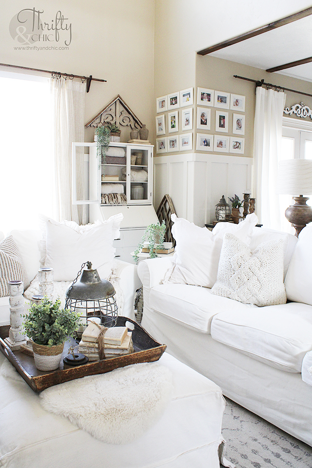 farmhouse style spring living room decor. Spring living room decorating ideas. White and woods living room decor. spring decorating ideas for the home. Two story living room decor. Ikea ektorp couches. Spring mantle decorating ideas. Neutral living room decor