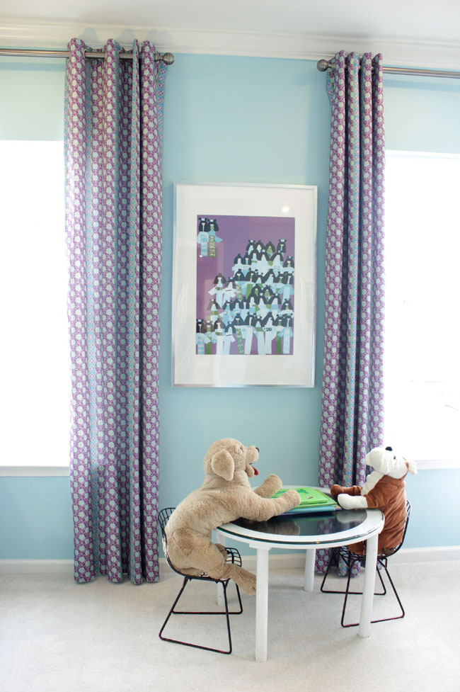 Purple and blue kids room with kid's table and teddy bears