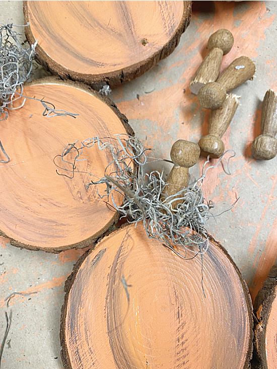 painted pumpkins and clothespin stems