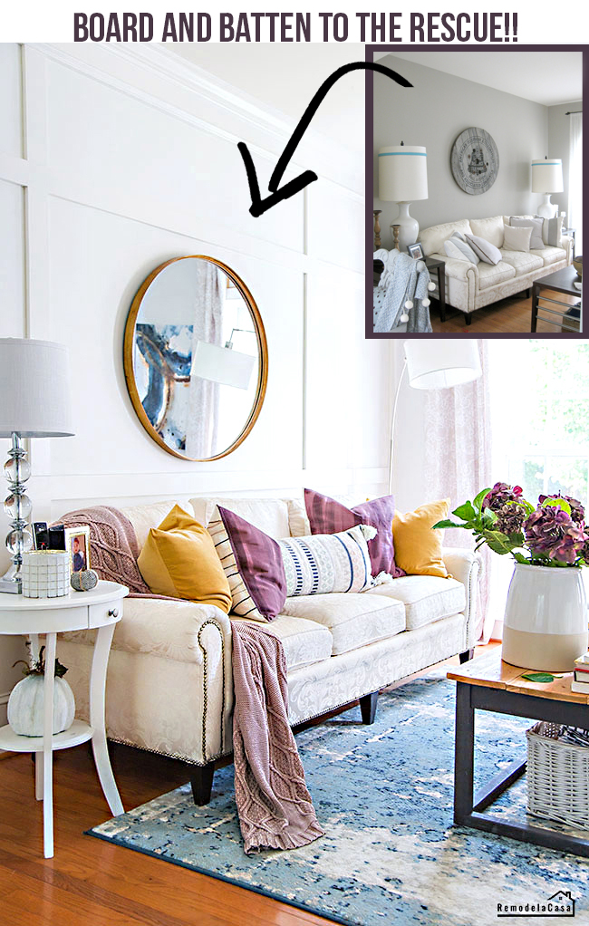 Family room with gold and plum accents, round mirror and wall and batten wall