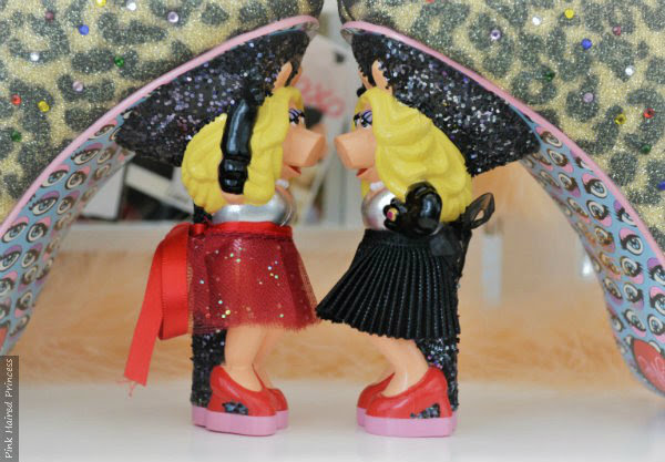 Miss Piggy character heels facing with one red skirt other in black skirt