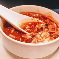 Serving hot and sour soup chicken