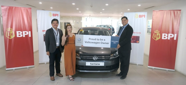Volkswagen Operations Manager Eduard Rivera (left) and BPI Division Head Raul Dimayuga (right) awards Mary Joy Watanabe the keys to her brand-new Volkswagen Santana. Watanabe regularly swipes her BPI Debit Mastercard when buying groceries, shopping, and when refilling at gas stations, as it is safer than bringing large amounts of cash.