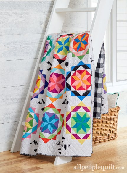 Color Catcher Quilt Designed by Erika Bea (@hello.erikabea on Instagram), The free pattern called Give Batiks a Spin Inspired by the original design of Color Catcher by Monique Jacobs for All People Quilt