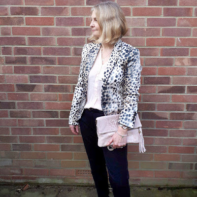 image showing leopard print jacket and blush blouse outfit
