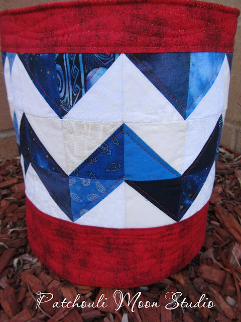 another closeup view of patchwork triangles on fabric bucket