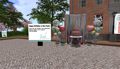 """A sign is posted in the Peale courtyard saying """"Happy Birthday to the Peale - Join us for our Founder's Day Celebration Sunday, August 15th at 3 pm SLT - Click for Details.""""  8 balloons are beside the sign.  Fun and colorful strips hang from a cord by the balloons.  In front of the strips is a round table with a two-tier cake in front of it.  Another set of 8 balloons is on the other side of the strips."""