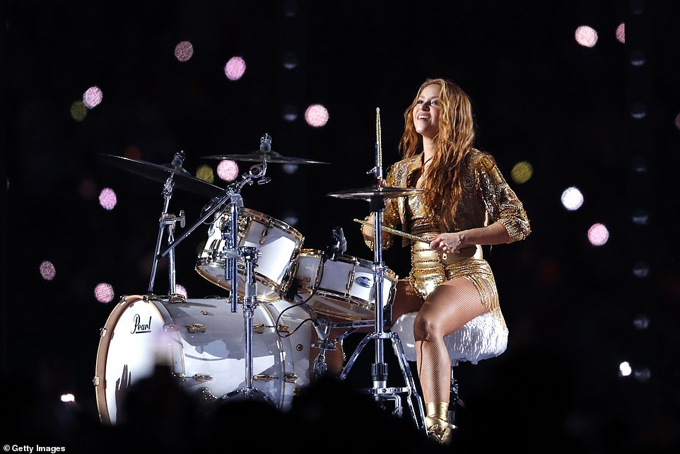 Shakira showed off her endless stream of talent as she made her way to a drum set