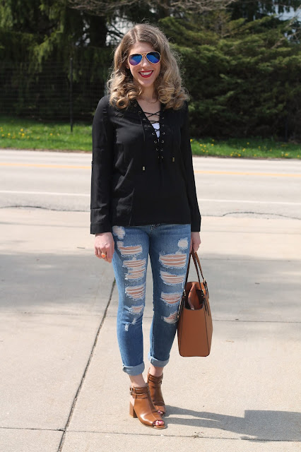 black lace up top, distressed jeans, cognac mules, Tory Burch tote