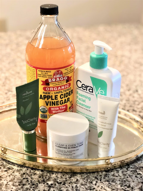 Bragg's apple cider vinegar, bioclarity restore moisturizer, urbanskinrx clear & even tone pads, bioclarity treat, cerave gentle cleanser