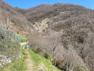 Trail out of Olera with Monte Colletto in background.