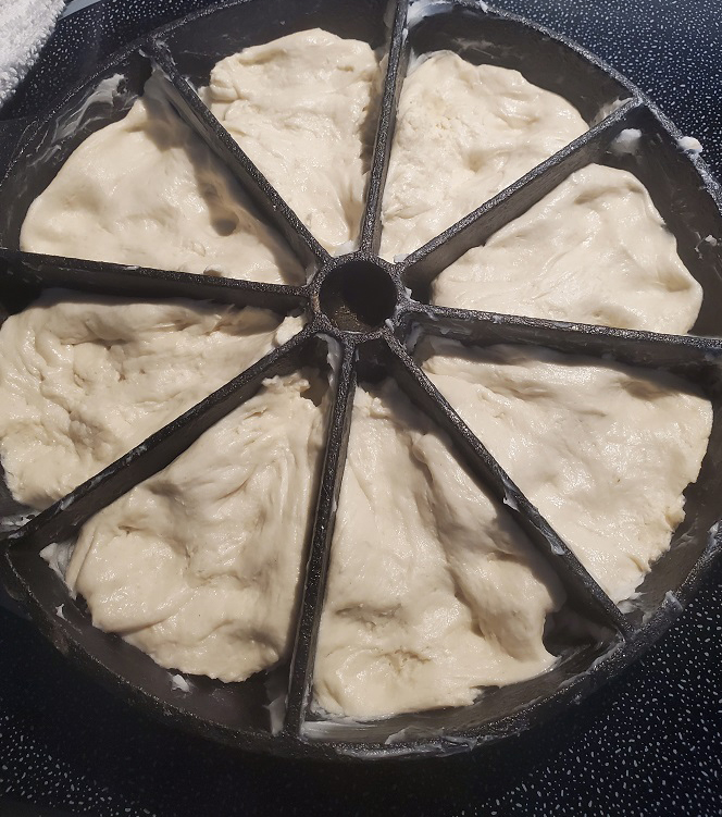 this is pizza dough rising in a cornbread pan for pan pizza on the grill