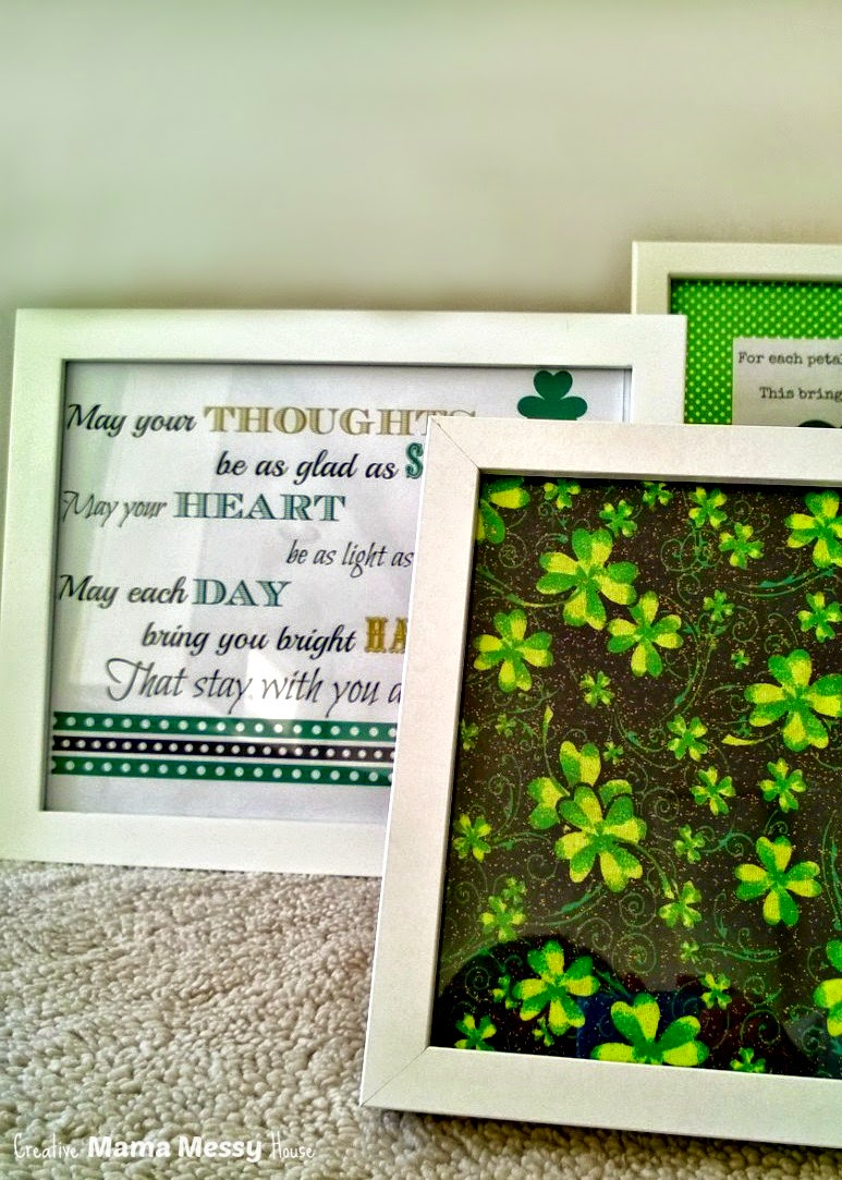 A collection of free printables, fabric remnants, and colorful scrapbook paper makes a fast, easy and cheap gallery wall project for St. Patrick's Day
