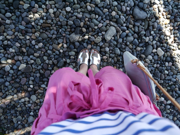 Marni x H&M metallic silver flat sandals worn with fuchsia silk shorts.