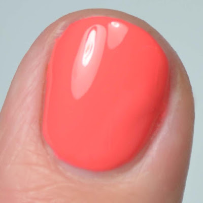 orange nail polish close up swatch