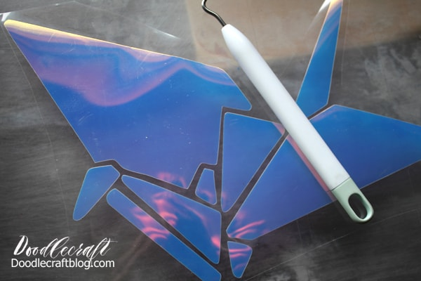 Use the Cricut Maker to cut origami paper crane, whale and bunny images out of iron on vinyl.