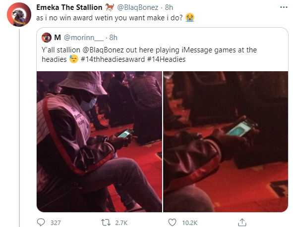 #14thheadies: Blaqbonez reacts after he was captured playing iMessage games at the Headies