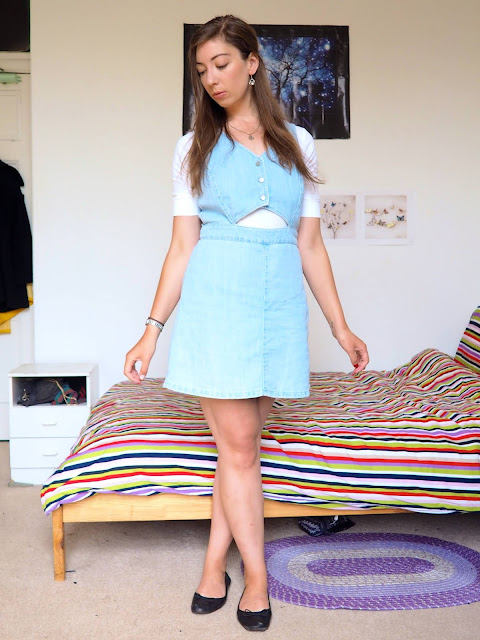Alice in Wonderland Disneybound outfit of blue denim dress, white top & black ballet flats