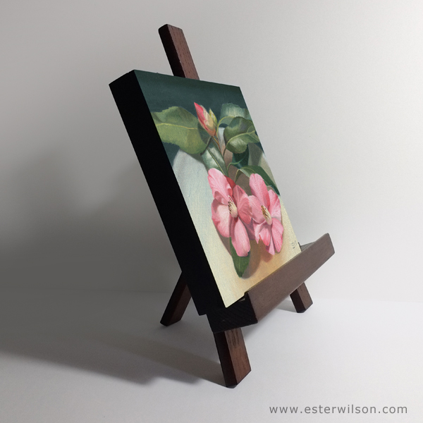 """""""Blooming Pinks"""" on a desktop easel - Oil painting on panel, 6 x 6 inches"""