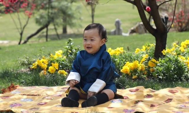 King Jigme Khesar Namgyel Wangchuck, Queen Jetsun Pema, Gyalsey Jigme Namgyel and Gyalsey Ugyen. Satin dress