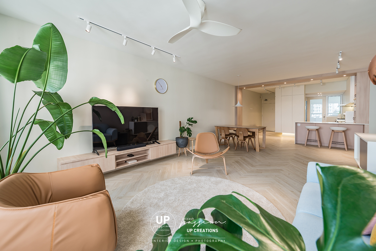 Mont Kiara Pines condo living area in minimalist style with a simple TV console and greens for the highlight