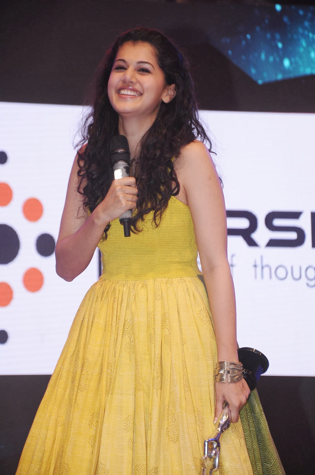 Tapsee Latest Hot Smiling Photos Stills In Yellow Dress