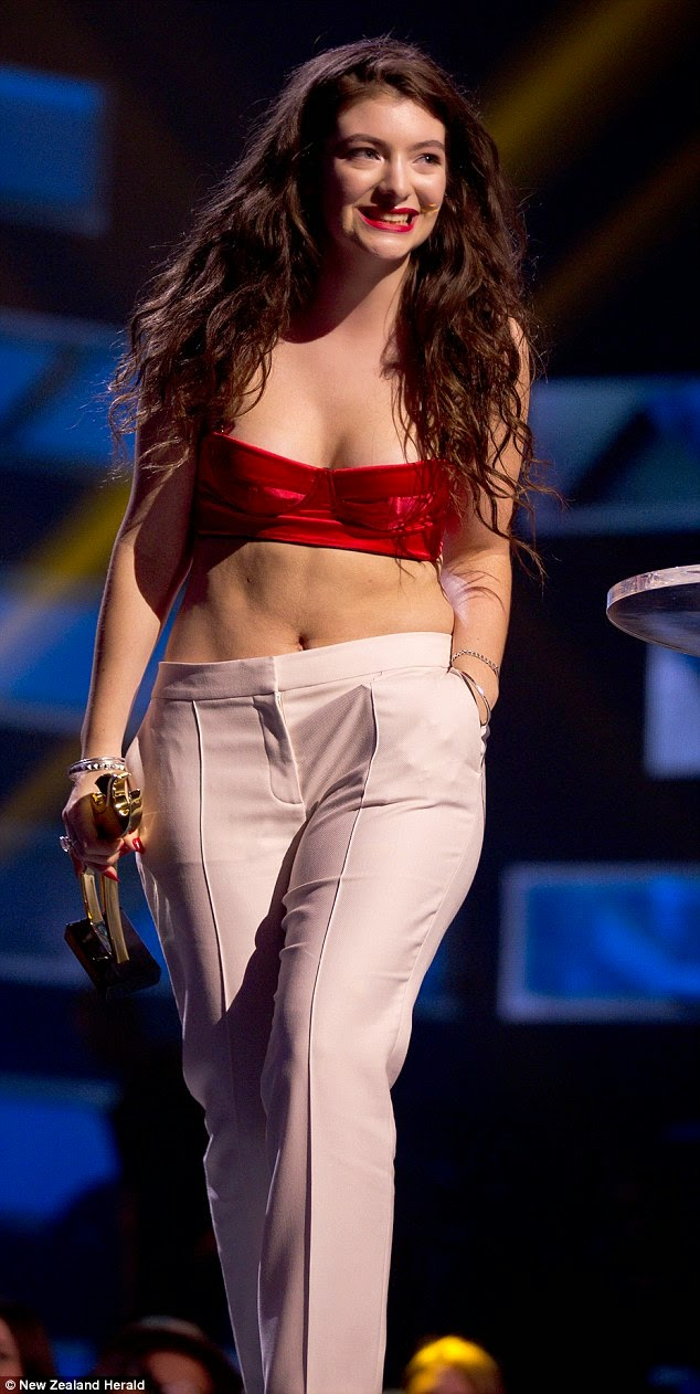 Lorde arrives at the 2014 New Zealand Music Awards in a white pant suit and red bralet