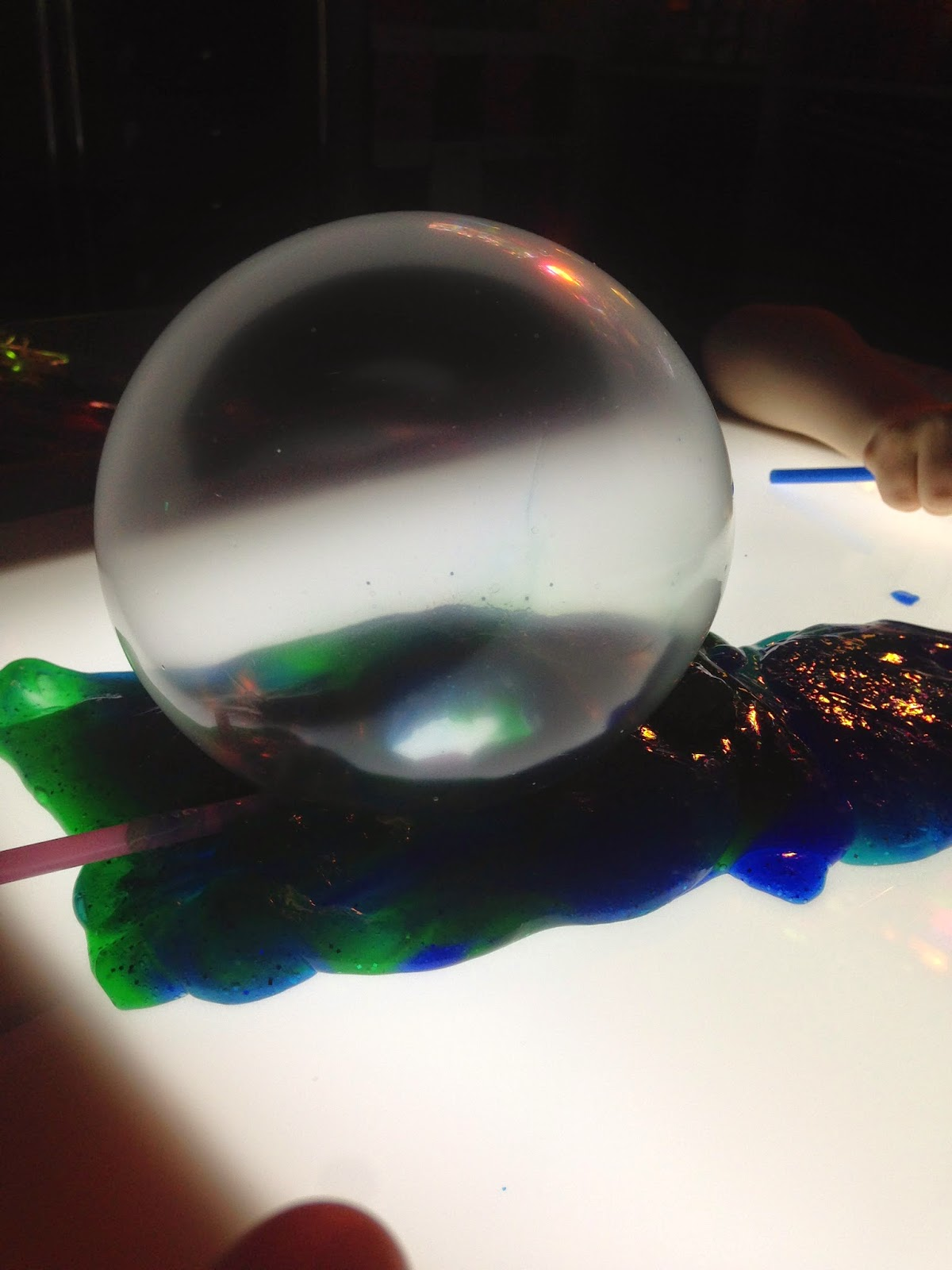 silly putty bubble on the light table made with a straw