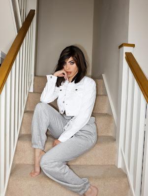 Femme Luxe White Cropped Denim Jacket in model Noemi