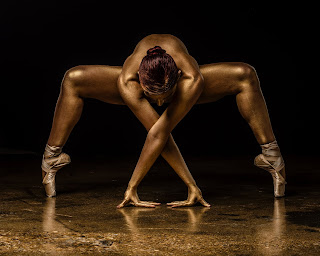 A Golden Ballerina Posed