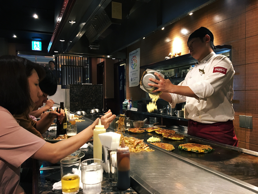 Live cooking at Okonomiyaki Mizuno in Osaka Japan