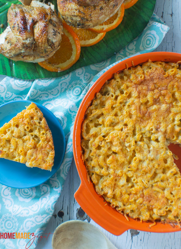 casserole of macaroni pie with a slice of pie and pieces of orange chicken