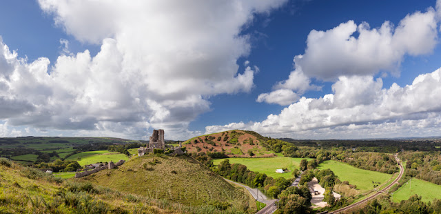 The ruins of Corfe Castle in Dorset looks over the surrounding landscape