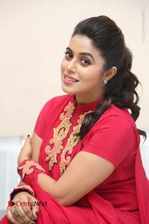 Actress Poorna Latest Stills in Red Dress at Rakshasi First Look Launch  0269.JPG