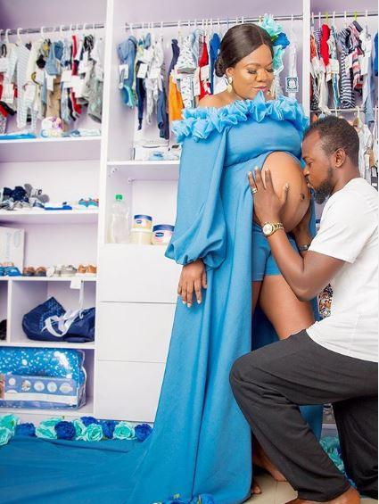 Toyin Abraham Puts Bare Baby Bump on Display Photo