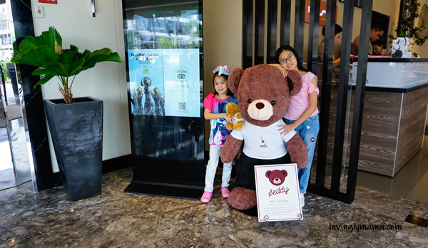 Seda Atria premier room review - Iloilo City - Iloilo hotels - Seda hotels - Philippines hotels - Bacolod blogger - Bacolod mommy blogger- family travel - homeschooling in  Bacolod - living room - Sedy bear - daughters - sisters - girls in love