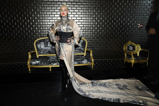 Christina Aguilera puts on a kooky display in a billowing kimono at the Jean Paul Gaultier PFW