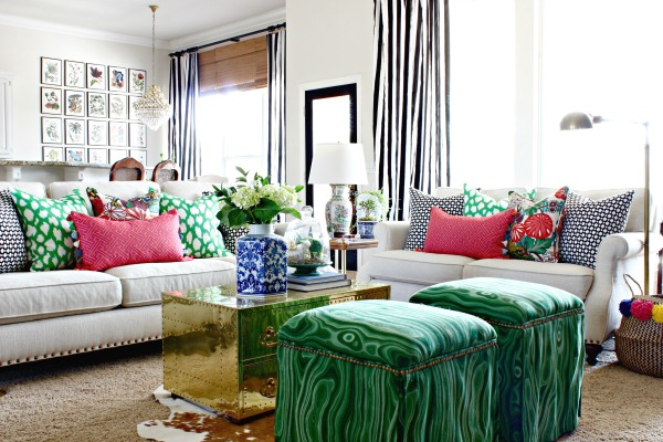 black and white striped curtains, neutral sofa, malakos malachite fabric, upholstered ottomans, brass trunk, cowhide rug, kate spade leokat pillow, schumacher betwixt, chiang mai dragon, botanical gallery wall