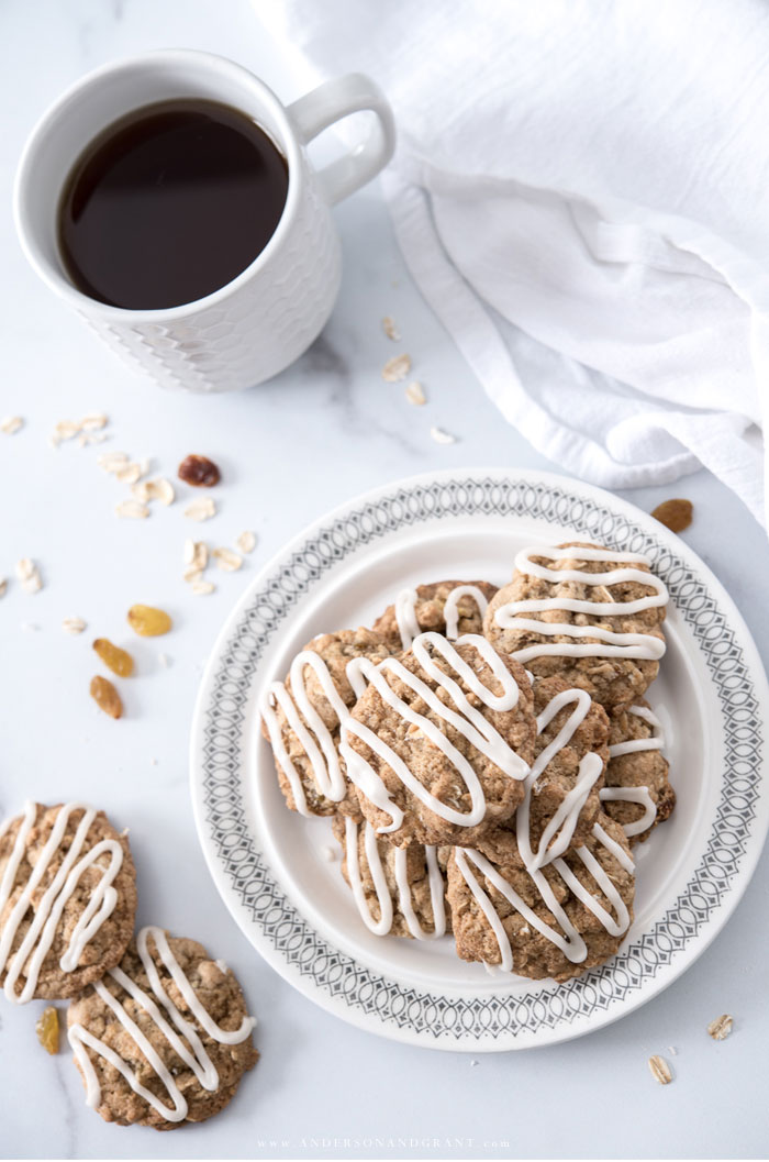 Plate of oatmeal cookies with glaze and coffee