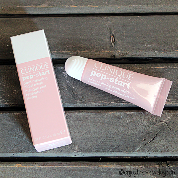 Tube (and product box) of Clinique's Pep-Start Pout Restoring Night Mask lying on a wooden table
