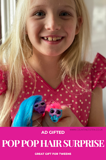 AD GIFTED POP POP HAIR SURPRISE REVIEW and image of girl with the toy