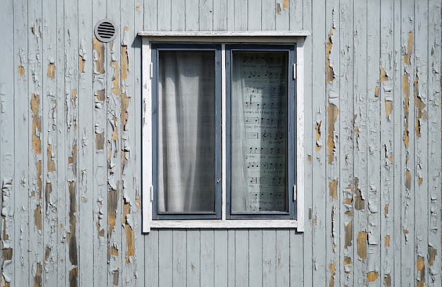 windows with sheet music curtins