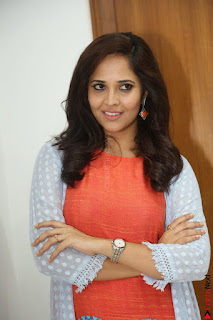 Actress Anasuya Bharadwaj in Orange Short Dress Glam Pics at Winner Movie Press Meet February 2017 (51).JPG