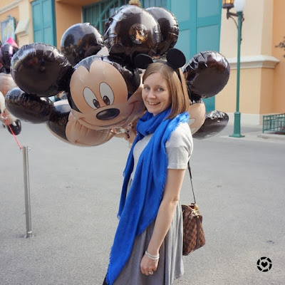 awayfromblue Instagram | mickey mouse balloons outfit pic disneyland studios Paris grey skater dress cobalt scarf